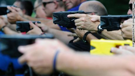 Law enforcement and park rangers use a variety of Tasers during training in 2014.