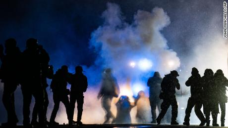 Protesters and police clash for a third night after Daunte Wright's death as prosecutors weigh charges against officer