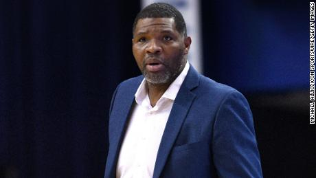 Evansville Purple Aces head coach Walter McCarty looks on during a basketball game in February 2019.