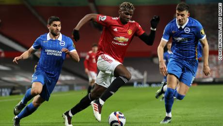 United midfielder Paul Pogba battles for possession with Jakub Moder (right) and Neal Maupay (left) of Brighton & Hove Albion.