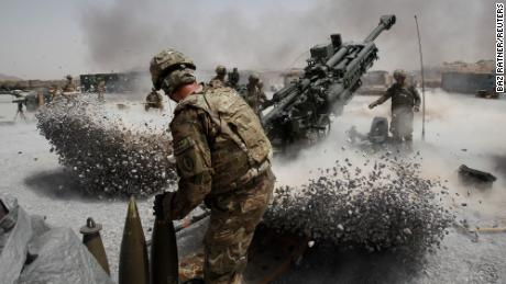 U.S. Army soldiers from the 2nd Platoon, B battery 2-8 field artillery, fire a howitzer artillery piece at Seprwan Ghar forward fire base in Panjwai district, Kandahar province southern Afghanistan, June 12, 2011. REUTERS/Baz Ratner (AFGHANISTAN - Tags: CONFLICT MILITARY IMAGES OF THE DAY POLITICS)