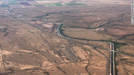 The Central Arizona Project canal runs through rural desert near Phoenix. Some farmers who receive Colorado River water from the Central Arizona Project could see their deliveries cut sharply as soon as next year.