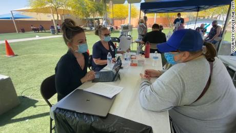 Alisha Crabtree, a physician assistant at Circle the City, sits across a table from Karen Williams shortly after Williams received her vaccine.