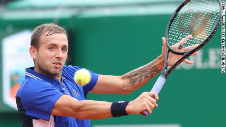 Evans in action during his quarterfinal match against Djokovic.