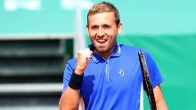 Evans celebrates winning his quarterfinal match against Djokovic.