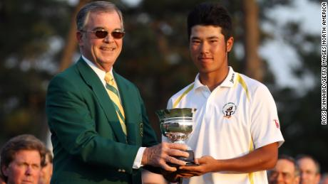 Matsuyama with the trophy for the low amateur after the final round of the 2011 Masters.