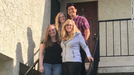 Shanan Cale, bottom right, pictured with her pod, including daughters Natalie Cale, 19, bottom left, Madeleine Cale, 23, top left, and Madeleine's boyfriend, Matt Sigala, 23.