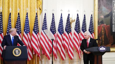 Bay of Pigs veteran Johnny Lopez de la Cruz and US President Donald Trump attend an event honoring Bay of Pigs veterans in the East Room of the White House in Washington, DC on September 23, 2020.