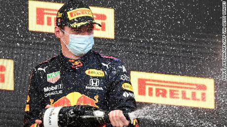 Max Verstappen celebrates after winning the Imola Grand Prix.