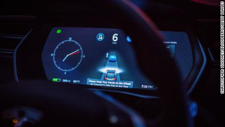 An instrument panel with the Tesla Motors Inc. 8.0 software update illustrates the road ahead using radar technology inside a Model S P90D vehicle in the Brooklyn borough of New York, U.S., on Tuesday, Sept. 20, 2016.