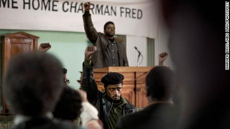 """FBI informant William O'Neal (LaKeith Stanfield) stands in the foreground, as Fred Hampton Sr. (Daniel Kaluuya) delivers a speech in the Oscar-nominated """"Judas and the Black Messiah."""""""