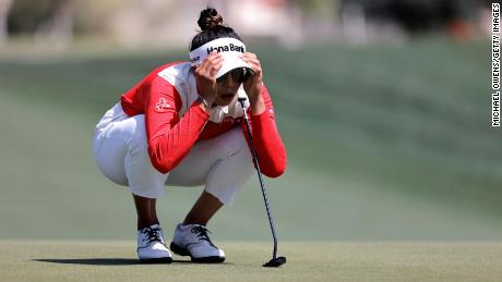 Tavatanakit finds his line before putting the first hole in the third round of the ANA Inspiration.
