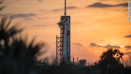 A SpaceX Falcon 9 rocket with the company's Crew Dragon spacecraft onboard is seen on the launch pad at Launch Complex 39A as preparations continue for the Crew-2 mission, Tuesday, April 20, 2021, at NASA's Kennedy Space Center in Florida.