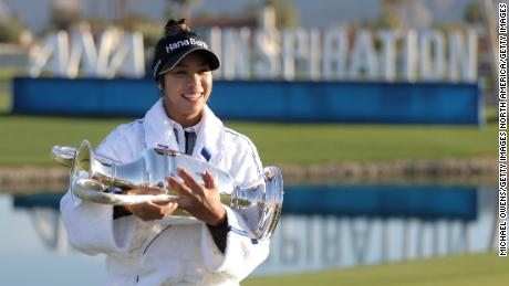 Tavatanakit poses with the trophy after winning the ANA Inspiration.