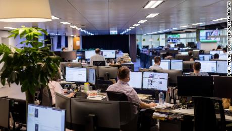 Employees work in the newsroom of the South China Morning Post (SCMP) in Hong Kong, on June 5, 2020.