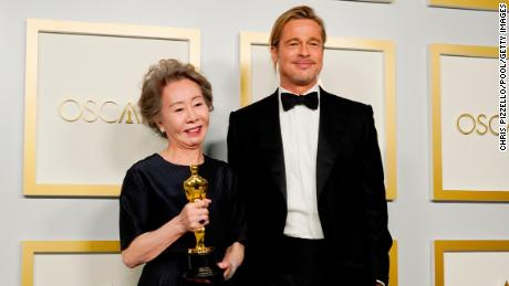 Yuh-jung Youn and Brad Pitt in the press room at the Academy Awards. (Photo by Chris Pizzello-Pool/Getty Images)