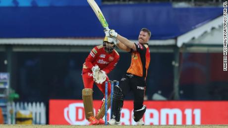 Warner plays a shot during the match against Punjab Kings.