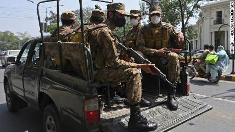 Army soldiers patrol on a street to implement new restrictions against Covid-19 in Lahore, Pakistan, on April 26.