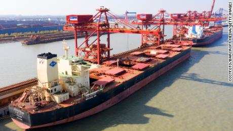 A ship unloading iron ore imported from Australia in Taicang Port in eastern China.