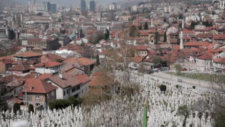 In the hills of Sarajevo, the war dead in Bosnia and Herzegovina are marked one after the other with uniform white graves.
