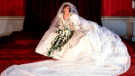 File photo dated 29/07/81 of the Princess of Wales seated in her bridal gown at Buckingham Palace after her marriage to Prince Charles at St. Paul's Cathedral.