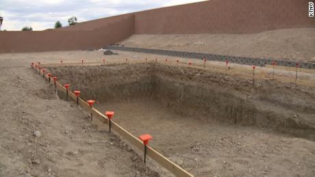 The couple are delaying the completion of the pool, so scientists can study the fossil.