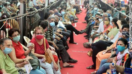 People wait in a queue to get vaccinated against Covid-19 on April 27, 2021 in Mumbai, India.