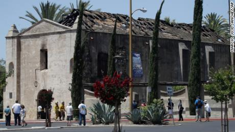 Man charged with setting fire to a historic Catholic church in Southern California