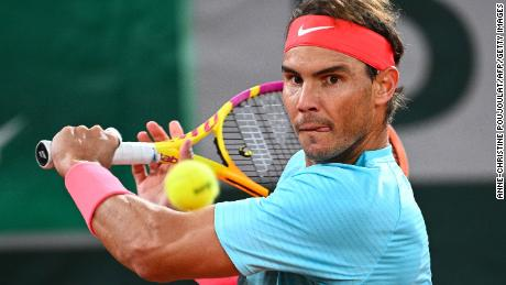 Nadal returns the ball to Novak Djokovic during their men's final tennis match at the 2020 French Open.