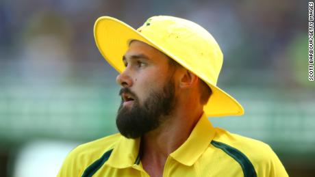 Kane Richardson of Australia looks on wearing a yellow floppy hat during game three of the One Day International Series between Australia and India at the Melbourne Cricket Ground on January 17, 2016 in Melbourne, Australia.