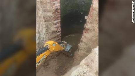 Multiple backhoes were used to demolish the side of the well and excavate a trench for the elephant to walk out on.