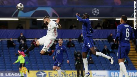 Real Madrid's Karim Benzema makes a header against Chelsea.