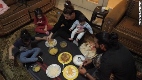 Khadija and her family gather for the nightly Iftar, composed nearly entirely of her neighbor's leftovers.