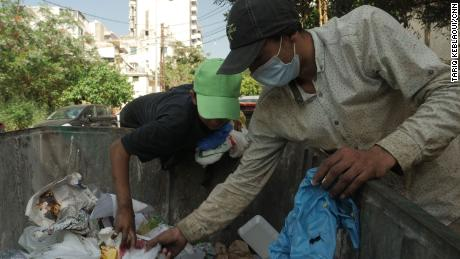 Ahmad scrounges for scrap and food in Beirut's dumpsters.