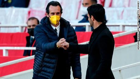 Mikel Arteta was beaten by the man he replaced, Villarreal's Spanish coach Unai Emery (L).