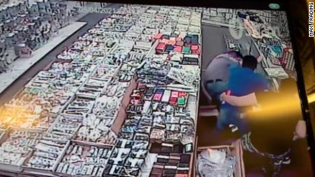 Surveillance video captured the assault of an Asian store owner on Tuesday in Washington, DC