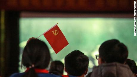 """Children watch a propaganda movie """"The Founding of a Party"""" in Yangzhou, in China's eastern Jiangsu province. Who needs Hollywood?"""