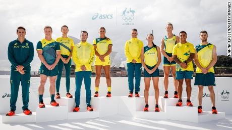 Australian Olympic athletes, including Maurice Longbottom, second from right, pose during the team's uniform unveiling in Sydney on March 31.