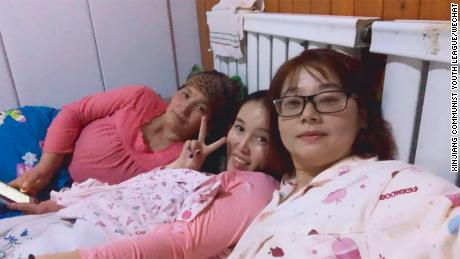 A photo posted online in 2017 shows two women in bed with a female host.