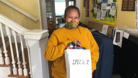Mekides Mengesha, a resident of Alexandria House, poses with her Mother's Day gift bag.