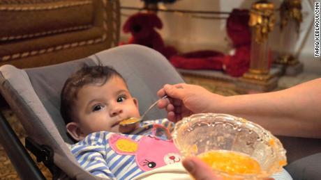 Khadija feeds her 5-month old daughter, Lamees.