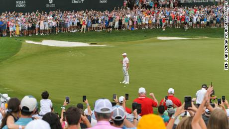 McIlroy fist pumps after making the winning putt on the 18th green at the Wells Fargo Championship.