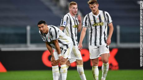 Juventus players look dejected during their defeat to AC Milan.