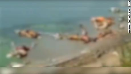 A screengrab from a video, blurred by CNN, shows the scene circulating on social media.