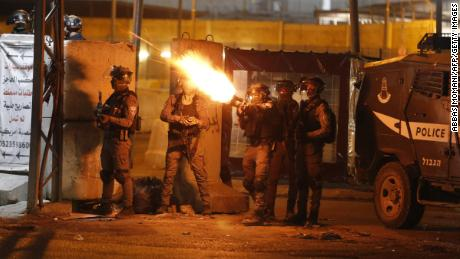 IDF soldiers fire tear gas at Palestinian demonstrators at the Qalandiya checkpoint between Ramallah and Jerusalem, in the West Bank on Tuesday.