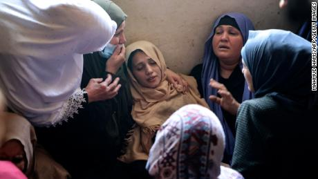 The mother of Palestinian Hussien Hamad, 11, is comforted by mourners during his funeral in Beit Hanoun in the northern Gaza Strip on Tuesday.