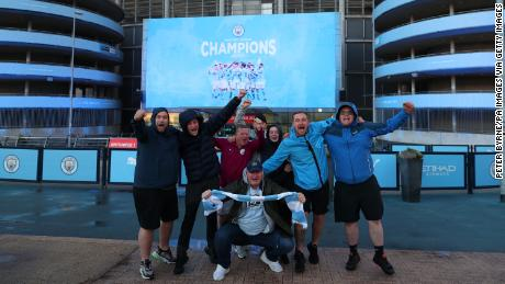 Fans celebrate at the Etihad Stadium after Manchester City was crowned Premier League champion.