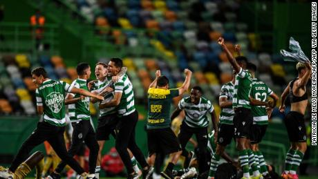 Sporting Lisbon players celebrate after winning the title.