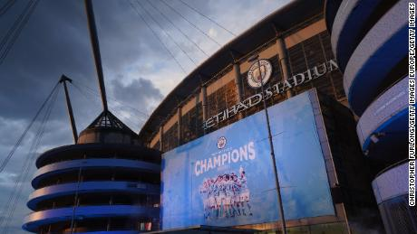 """A large display outside Etihad Stadium reads """"Champions"""" as Manchester City has been confirmed as Premier League champions."""