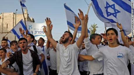 """Israelis take part in the annual Jewish nationalist """"Jerusalem Day"""" march on Monday."""